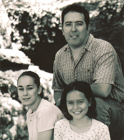 Father, tean and subteen daughters