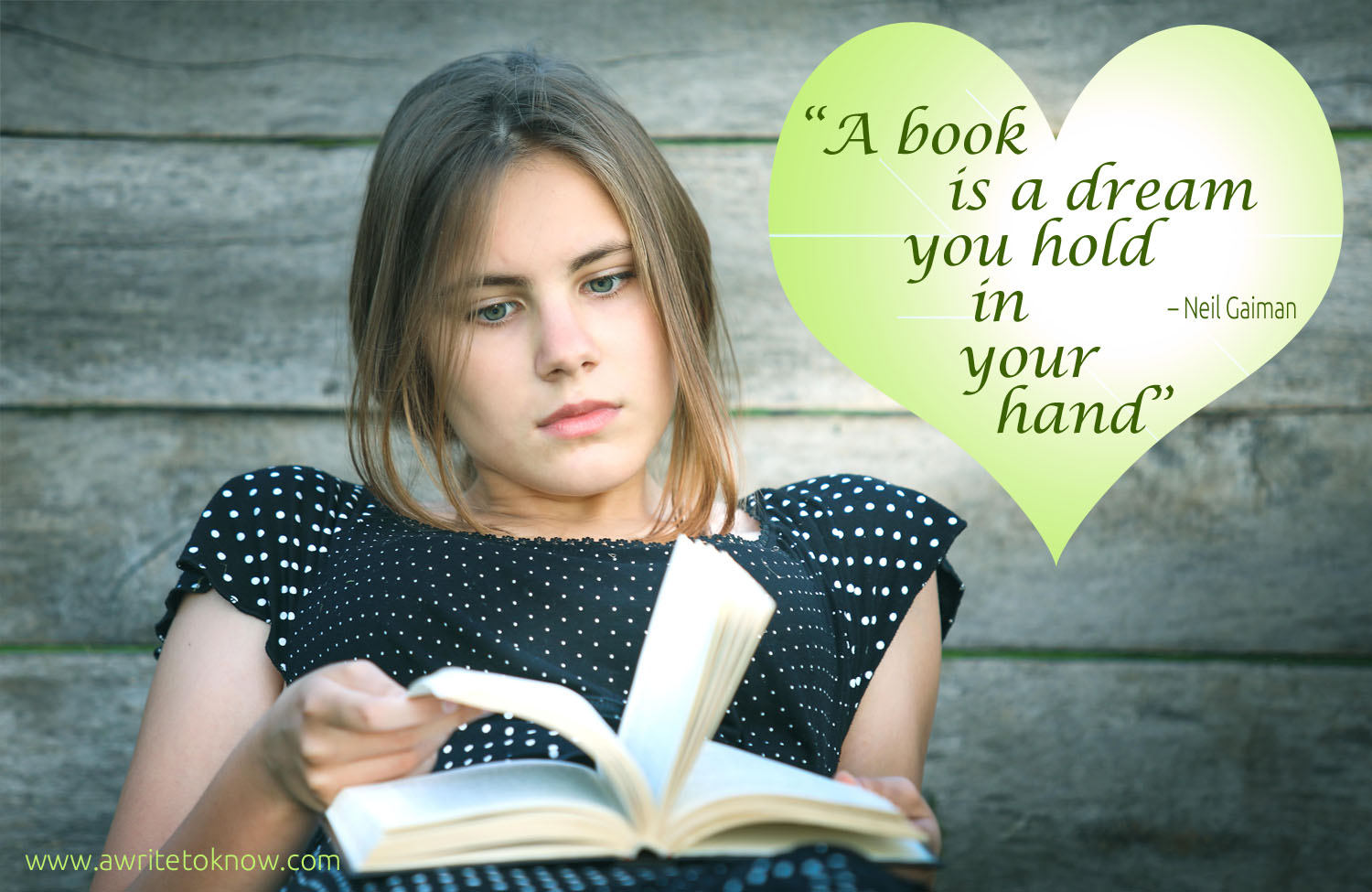 "A girl reflects as she holds a book, with text that says ""A Book is a Dream You Hold in Your Hand"""