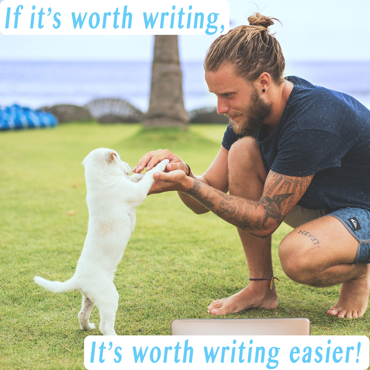 """A young man plays with his white shih tzu puppy on the grass at the beach, taking a break from writing on his laptop. The words say, """"If it's worth writing, it's worth writing easier."""""""